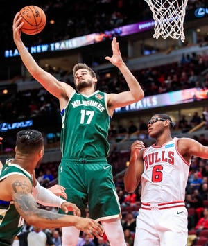 Dragan Bender of the Bucks pulls down a rebound against the Bulls during a game last October. In addition to playing with the Bucks this season, Bender has spent time with the Wisconsin Herd of the the G League, where is averaging 21.1 points, 9.2 rebounds and 1.8 blocks.