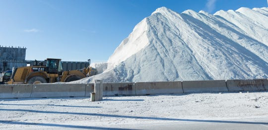 A front-end loader works non-stop filling dozens of waiting trucks with salt Wednesday, January 8, 2020 on Jones Island in Milwaukee, Wis.