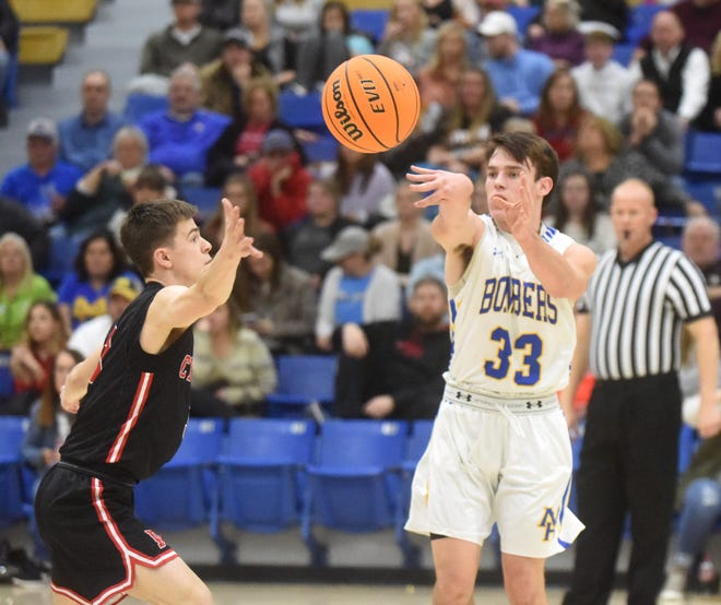 Mountain Home's Adam Sorrell passes to a teammate during the Bombers' 51-42 victory over Russellville on Tuesday night.