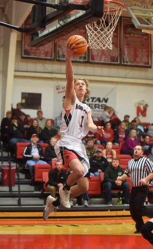 Norfork's Dawson Gray soars in for two points during a recent game at Norfork.