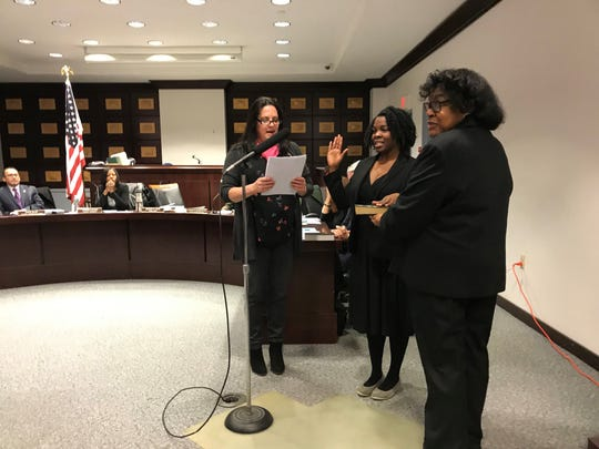 Councilwoman Tawanna Cotten of the 2nd Ward is sworn in to the Morristown Town Council Tuesday evening by Town Clerk Margot Kaye. She is joined by her mother.