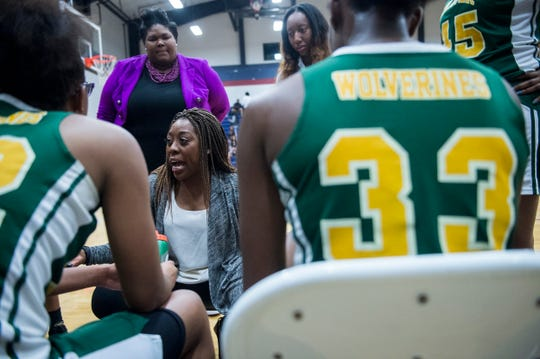 Carver coach Adria Harris talks with her team during a timeout at Park Crossing High School in Montgomery, Ala., on Tuesday, Jan. 7, 2020.