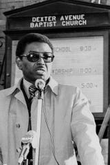 Herman Harris in front of Dexter Avenue Baptist Church in this 1978 file photo.