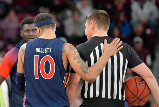 Auburn guard Samir Doughty (10) talks with an official during a game at Mississippi State at Humphrey Coliseum on Jan. 4, 2020, in Starkville, Miss.