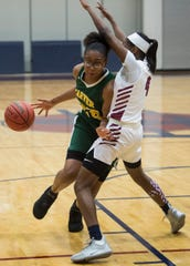Carver's Mya Barnes (22) drives the ball at Park Crossing High School in Montgomery, Ala., on Tuesday, Jan. 7, 2020.