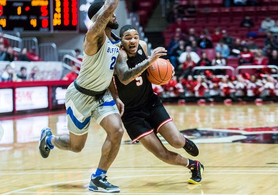 Ball State's Ishmael El-Amin fights past Buffalo's defense during their game at Worthen Arena Tuesday, Jan. 7, 2020.