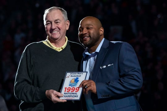 Feb 24, 2019; Hartford, CT, USA; Former Connecticut Huskies head coach Jim Calhoun (left) along with former huskies star Khalid El-Amin and other team members (not pictured) from the 1999 NCAA Championship team were honored on the court during halftime between the Huskies and the Cincinnati Bearcats at XL Center. Mandatory Credit: David Butler II-USA TODAY Sports