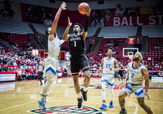 Ball State's K.J. Walton shoots past Buffalo's defense during their game at Worthen Arena Tuesday, Jan. 7, 2020.