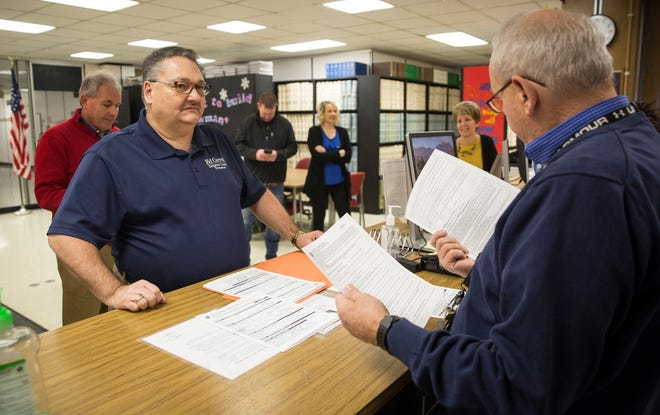 Ed Carroll files paperwork at the Delaware County Clerks office Wednesday morning to run as a Republican for the county treasurer in the 2020 election.