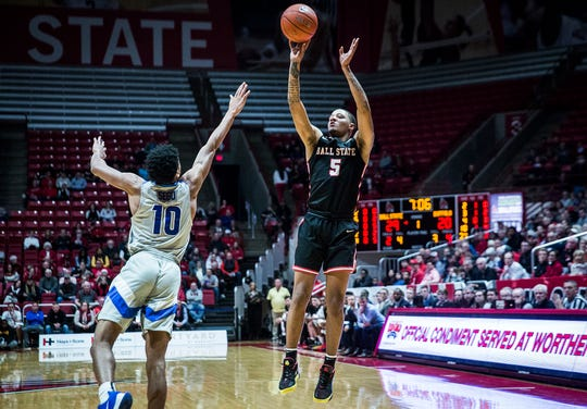 Ball State's Ishmael El-Amin shoots past Buffalo's defense during their game at Worthen Arena Tuesday, Jan. 7, 2020.