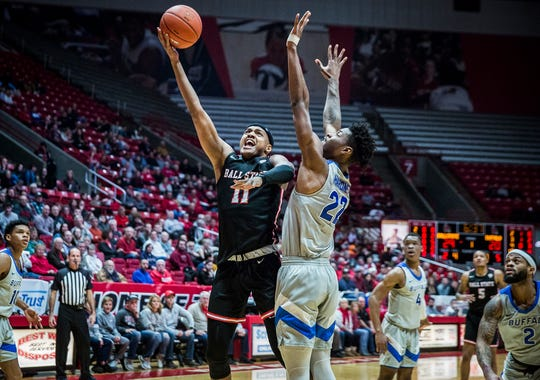 Ball State's Jarron Coleman shoots past Buffalo's defense during their game at Worthen Arena Tuesday, Jan. 7, 2020.