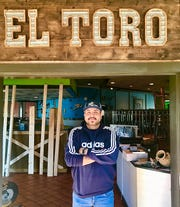 Adan Deleon stands in front of the sign inside El Toro, his Mexican restaurant that is taking over the space at the former O'Charley's at 1006 Memorial Blvd. in Murfreesboro.