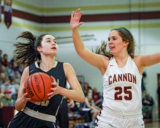 Central Magnet's Addison Melton goes up as Cannon County's Shelby Smithson defends Tuesday.