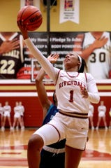 Riverdale's Alasia Hayes goes up for a shot during a recent game. Hayes exploded for 43 points in a 66-52 win over Oakland Tuesday.