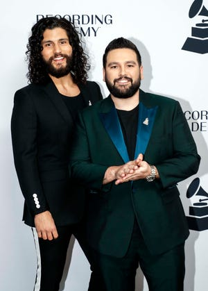 Dan Smyers and Shay Mooney pose for a photo during a Grammy Awards party at the Hutton Hotel, Tuesday, Jan. 7, 2020, in Nashville, Tennessee.