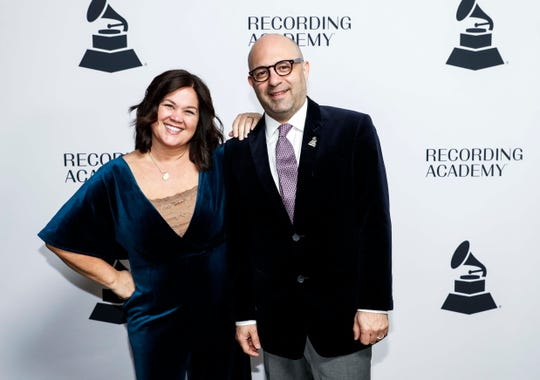 Daniel Tashian and Carla Wallace pose for a photo as they walk the red carpet before a Grammy Awards party at the Hutton Hotel, Tuesday, Jan. 7, 2020, in Nashville, Tennessee.