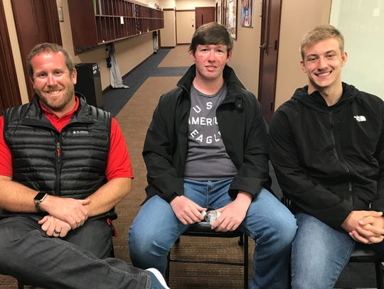 Brentwood Academy math teacher Chandler Ganick (left) sits with seniors Garrett Crouch (center) and Ethan Oesterle (right) after returning from Costa Rica. The three, along with literature teacher Jimmy Ker, were left adrift in the Pacific Ocean after their fishing boat capsized during a school trip to Costa Rica.