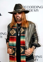 Billy Ray Cyrus poses for a photo as he walks the red carpet before a Grammy Awards party at the Hutton Hotel, Tuesday, Jan. 7, 2020, in Nashville, Tennessee.