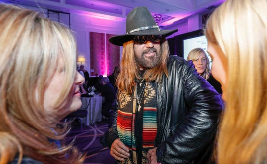 Billy Ray Cyrus talks to guests during a Grammy Awards party at the Hutton Hotel, Tuesday, Jan. 7, 2020, in Nashville, Tennessee.