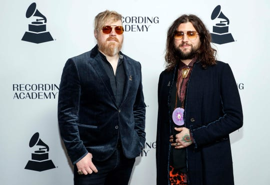 Members of Rival Sons pose for a photo as they walk the red carpet before a Grammy Awards party at the Hutton Hotel, Tuesday, Jan. 7, 2020, in Nashville, Tennessee.