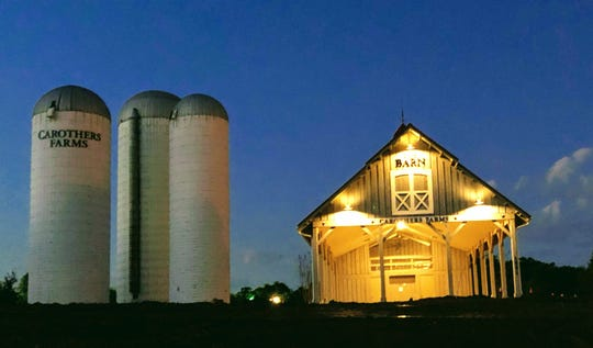 Regent Homes preserved the trio of farm silos at the entrance of Carothers Farms. Community events and parties are held in the barn.