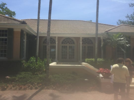 BEFORE: Front elevation of the home in Oak Knoll at Bonita Bay.