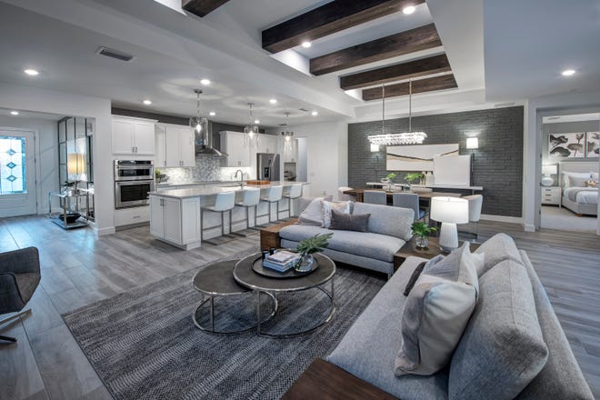 The Stardom floor plan offers ideal spaces for entertaining, with a cook's kitchen and oversized island looking over the connected gathering areas.