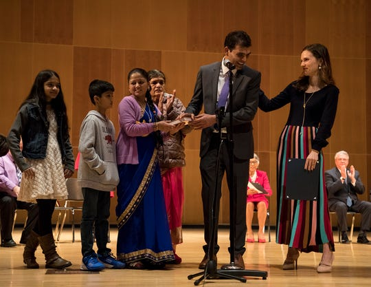 Bhuwan Pyakurel is sworn into office by Elizabeth Brown, daughter of Senator Sherrod Brown and a member of Columbus City Council. His wife, Dil, held the Bhagavad Gita for her husband to be sworn in on while his children and mom joined him on stage.