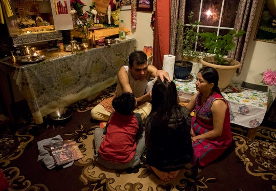 For Bhuwan Pyakurel and his family their Hindu faith is vitally important. Every morning they gather in the 'temple' in their home to pray.
