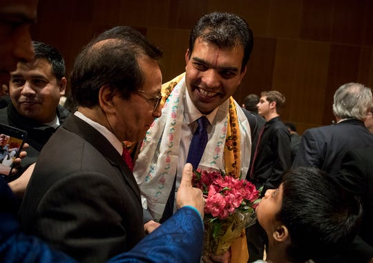 Bhuwan Pyakurel shakes the hands of friends, family members and supporters after being sworn into office on Reynoldsburg City Council. Pyakurel is considered to be the first Nepali-Bhutanese person elected to office in the United States.
