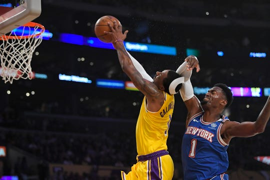 New York Knicks forward Bobby Portis, right, fouls Los Angeles Lakers guard Kentavious Caldwell-Pope during the first half of an NBA basketball game Tuesday, Jan. 7, 2020, in Los Angeles. Portis was ejected from the game after the foul.