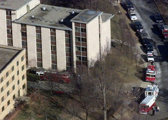 Emergency fire vehicles surround a dormitory building at Seton Hall University in South Orange, N.J., in this Wednesday, Jan. 19, 2000, file photo, where an early morning fire killed three people. Two former college students charged with setting the dorm fire reached a plea agreement with prosecutors Wednesday, Nov. 15, 2006, the day their trial was to begin.