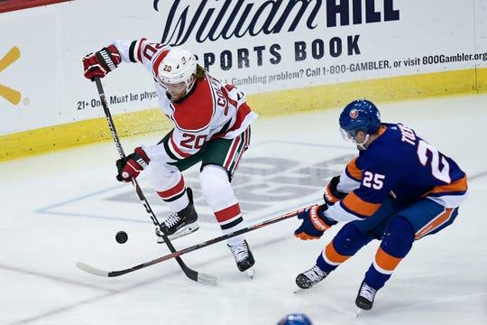 New Jersey Devils center Blake Coleman (20) plays against New York Islanders defenseman Devon Toews (25). The New Jersey Devils face the New York Islanders on Tuesday, Jan. 07, 2020, in Newark.