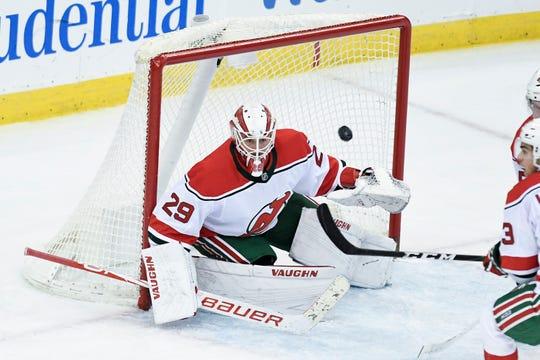 New Jersey Devils goaltender Mackenzie Blackwood (29) makes a save against the Islanders. The New Jersey Devils face the New York Islanders on Tuesday, Jan. 07, 2020, in Newark.