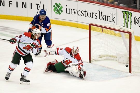New Jersey Devils goaltender Mackenzie Blackwood (29) misses a goal by the New York Islanders in the first period. The New Jersey Devils face the New York Islanders on Tuesday, Jan. 07, 2020, in Newark.