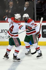 New Jersey Devils defenseman P.K. Subban (76) and New Jersey Devils left wing Miles Wood (44) celebrate SubbanÕs goal in the first period. The New Jersey Devils face the New York Islanders on Tuesday, Jan. 07, 2020, in Newark.