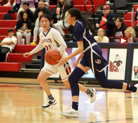 Senior Lady 'Cat Brooke Huerta shadows Silver's Aryana Gomez in the back court.