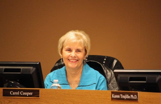 School board member Carol Cooper smiles as she is introduced during the school board meeting on Tuesday, Jan. 7, 2020.