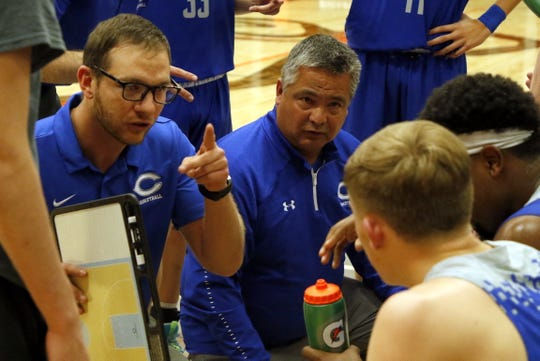 Carlsbad assistant coach Matt Enloe, left talks to the Cavemen during a timeout against  Artesia on Jan. 7, 2020. Carlsbad won, 48-38.