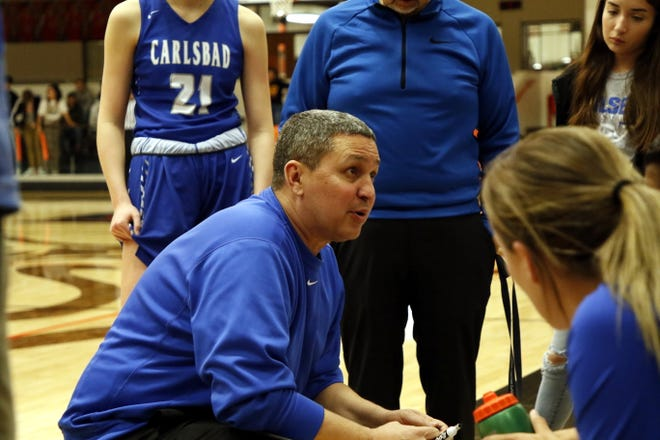 John Zumbrun talks to his Carlsbad Cavegirls during a timeout against the Artesia Lady Bulldogs on Jan. 7, 2020. Zumbrun will take over as the Cavemen head coach after leading the Cavegirls for 12 years.