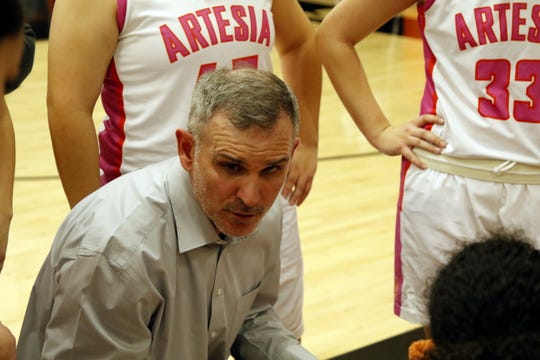 Artesia girls head coach Jeff Houghtaling talks to his team during a timeout against Carlsbad on Jan. 7, 2020. Carlsbad won, 45-35.