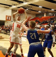 Artesia's Braxton McDonald takes a contested shot in the first half against the Carlsbad Cavemen on Jan. 7, 2020. McDonald finished withseven points.  Carlsbad won, 48-38.