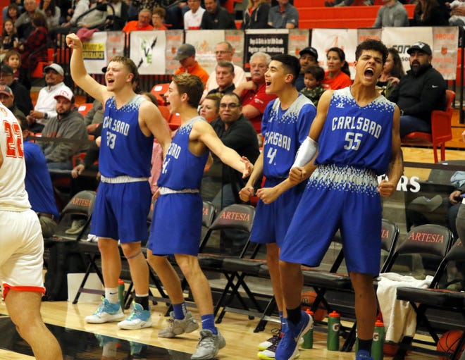 Carlsbad's bench reacts to a third quarter 3-pointer by Trai Calderon against the Artesia Bulldogs on Jan. 7, 2020. Carlsbad won, 48-38.
