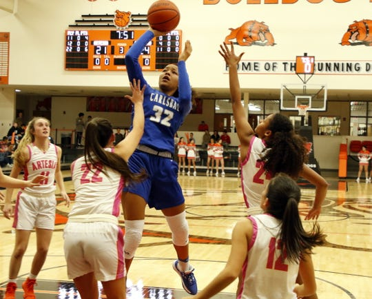 Carlsbad's Allie Myers shooters over Artesia's Cora Cox on Jan. 7, 2020. Myers finished with 12 points and Carlsbad won, 45-35.