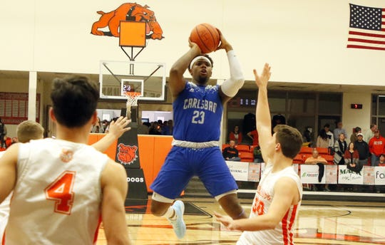 Carlsbad's Shamar Smith gets off a contested jump shot against the Artesia Bulldogs on Jan. 7, 2020. Smith finished with 18 points and Carlsbad won, 48-38.