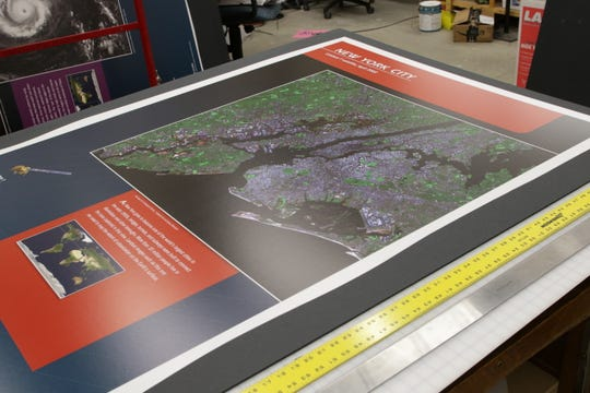 "A satellite image of New York City is processed at the Farmington Museum at Gateway Park in preparation for the opening of the ""Earth from Space"" exhibition this weekend."