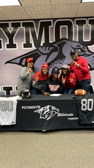Plymouth's Ivan Davis poses with his family after signing to play football at Northern Illinois.