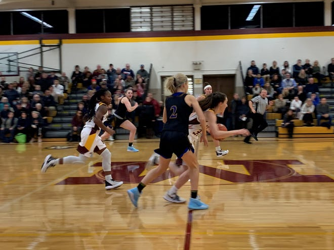 Mercy's Maddie Kenney gets a steal at mid-court and runs it back for a layup against Marian defender Sophia Mancini.