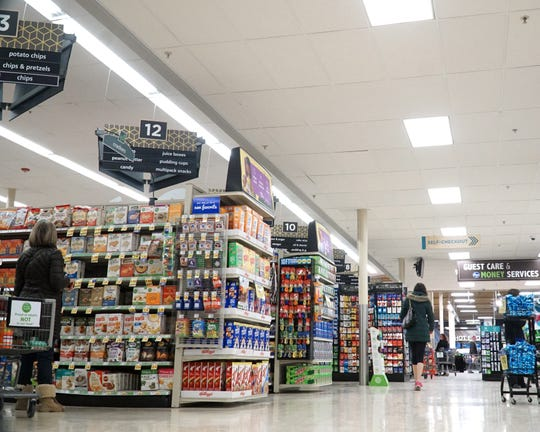 Milford's Kroger has new aisle marking signs visible from good distances within the store.