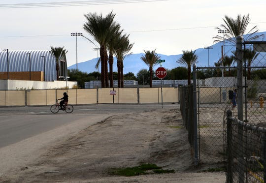 A bicyclist rides along Avenue 48 on the border of Indio and Coachella, Calif., near the construction site of Hotel Indigo on Friday, Jan. 3, 2020.